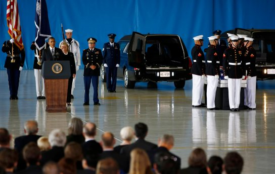 U.S. President Obama and Secretary of State Clinton participate in a transfer ceremony of the remains of U.S. Ambassador to Libya, Chris Stevens and three other Americans killed this week in Benghazi, at Andrews Air Force Base near Washington