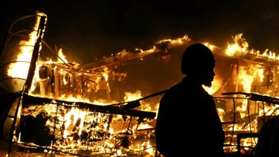 a Ferguson rebellion building burning down on Nov. 25, 2014