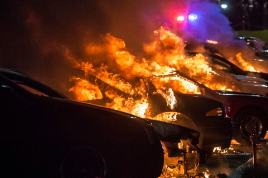 Vehicles at a car dealership are set afire in Ferguson, Missouri