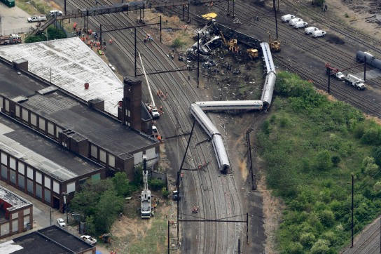 In an aerial photo, emergency personnel work at the scene of a deadly train wreck, Wednesday, May 13, 2015, in Philadelphia, after a fatal Amtrak derailment Tuesday night, in the Port Richmond section of Philadelphia. Federal investigators arrived Wednesday to determine why an Amtrak train jumped the tracks in a wreck that killed at least six people, and injured dozens. (AP Photo/Patrick Semansky)