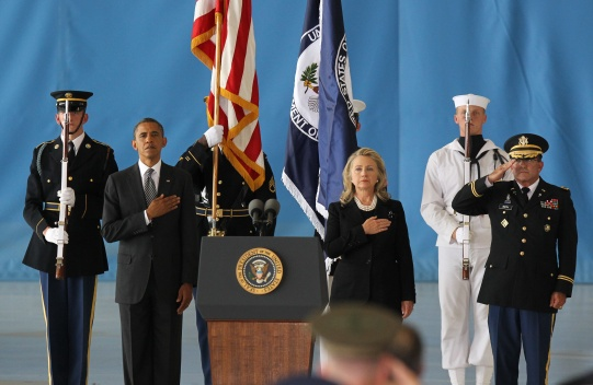 epa03398098 US President Barack Obama (2-L) and Secretary of State Hillary Clinton (3-R) take part in the Transfer of Remains Ceremony marking the return to the United States of the remains of the four Americans killed this week in Benghazi, Libya, at Joint Base Andrews in Washington DC, USA, 14 September 2012. Gunmen attacked the US consulate in Benghazi, killing of US ambassador to Libya, Christopher Stevens, and three embassy staffs. EPA/MOLLY RILEY / POOL