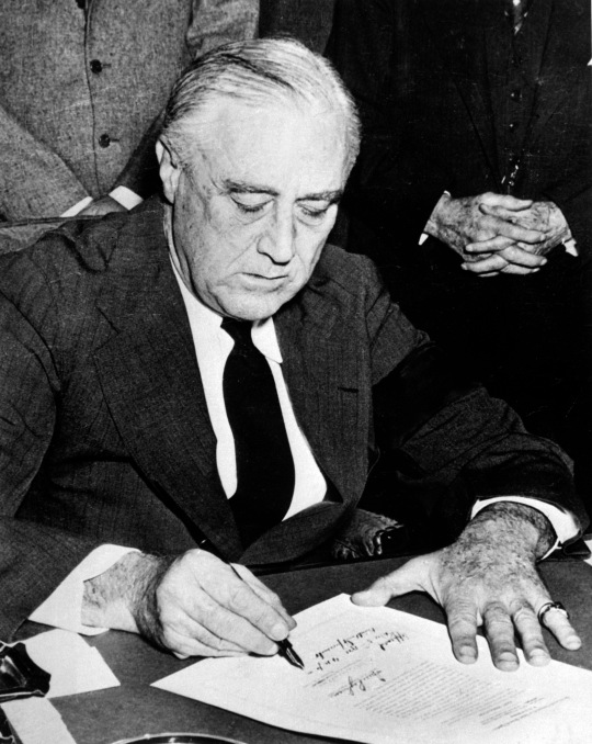President Franklin D. Rossevelt signing the declaration of war against Japan, December 8, 1941. (National Park Service) NARA FILE #: 079-AR-82 WAR & CONFLICT BOOK #: 743