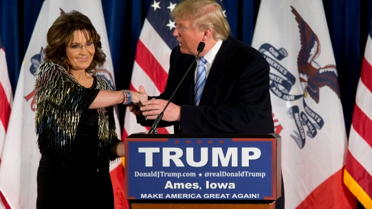 Former Alaska Gov. Sarah Palin, left, endorses Republican presidential candidate Donald Trump during a rally at the Iowa State University, Tuesday, Jan. 19, 2016, in Ames, Iowa. (AP Photo/Mary Altaffer)