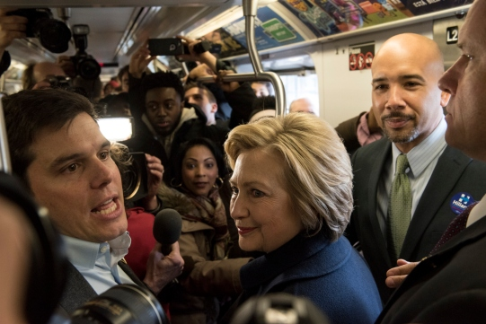 NEW YORK, NEW YORK - APRIL 07: Democratic presidential candidate Hillary Clinton rides the No. 4 train with borough President Ruben Diaz Jr. as she campaigns on April 7, 2016 in the Bronx borough of New York City. The former U.S. secretary of state first spoke outside of Yankee Stadium before riding the subway from the 161st Street station to the 170th Street station. (Photo by Andrew Renneisen/Getty Images)