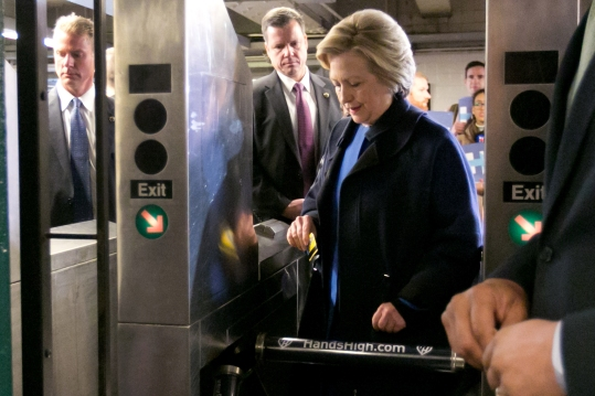 Democratic presidential candidate Hillary Clinton holds her Metrocard as she goes through the turnstile to enter the subway in the Bronx borough of New York, Thursday, April 7, 2016. (AP Photo/Richard Drew) ORG XMIT: NYRD107