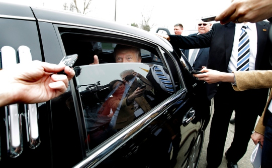 Testing the presidential waters, Donald Trump talks to the press from inside his limo after touring a business in Newington, N.H., Wednesday April 27, 2011.