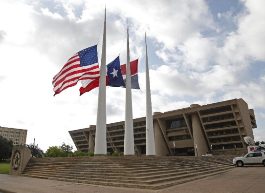DALLAS, TX - JULY 8: Flags fly at half mast at Dallas City Hall following the fatal shootings of five police officers on July 8, 2016 in Dallas, Texas. Micah Xavier Johnson has been identified as the suspected sniper in the fatal shooting of five police officers, and injuring seven more at a Black Lives Matter demonstration held on July 7, 2016 in Dallas, Texas. Stewart F. House/Getty Images/AFP