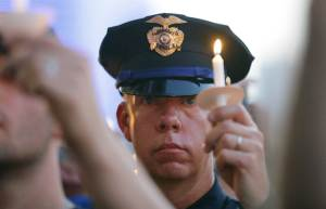 dallas police officer with candle