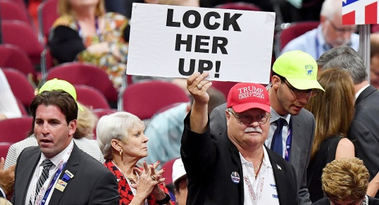 "CLEVELAND, OH - JULY 20: A Florida delegate holds up a sign that reads ""Lock Her Up!"" prior to the start of the third day of the Republican National Convention on July 20, 2016 at the Quicken Loans Arena in Cleveland, Ohio. Republican presidential candidate Donald Trump received the number of votes needed to secure the party's nomination. An estimated 50,000 people are expected in Cleveland, including hundreds of protesters and members of the media. The four-day Republican National Convention kicked off on July 18. (Photo by Jeff J Mitchell/Getty Images)"