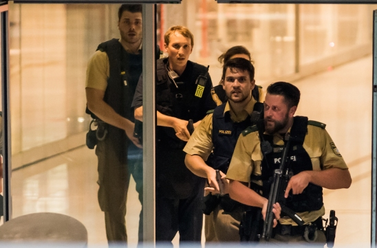 MUNICH, GERMANY - JULY 22: Police officers respond to a shooting at the Olympia Einkaufzentrum (OEZ) at July 22, 2016 in Munich, Germany. According to reports, several people have been killed and an unknown number injured in a shooting at a shopping centre in the north-western Moosach district in Munich. Police are hunting the attacker or attackers who are thought to be still at large. (Photo by Joerg Koch/Getty Images)