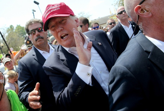 DES MOINES, IA - AUGUST 15: Republican presidential candidate Donald Trump greets fairgoers while campaigning at the Iowa State Fair on August 15, 2015 in Des Moines, Iowa. Presidential candidates are addressing attendees at the Iowa State Fair on the Des Moines Register Presidential Soapbox stage and touring the fairgrounds. The State Fair runs through August 23. (Photo by Win McNamee/Getty Images)